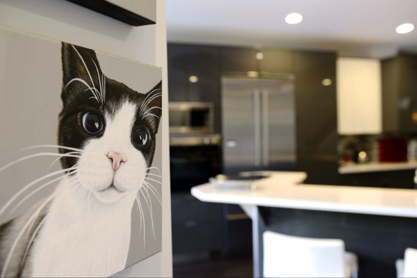 Lily painting shown on wall against their modern kitchen finishings.